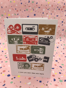 A retro style card with lots of cassette tapes on the front