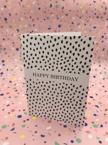 A spotty black and white cards