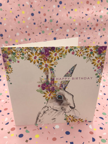 A floral card with a grey hare painted on