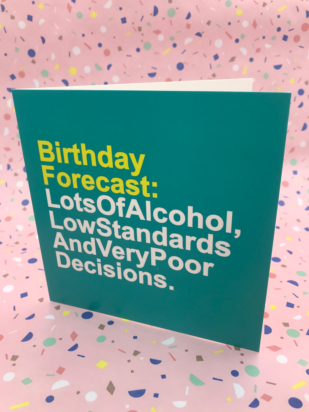 A green and yello typography card about alcohol and poor decisions