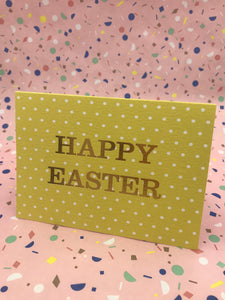 A yellow card with gold embossed dots saying happy easter