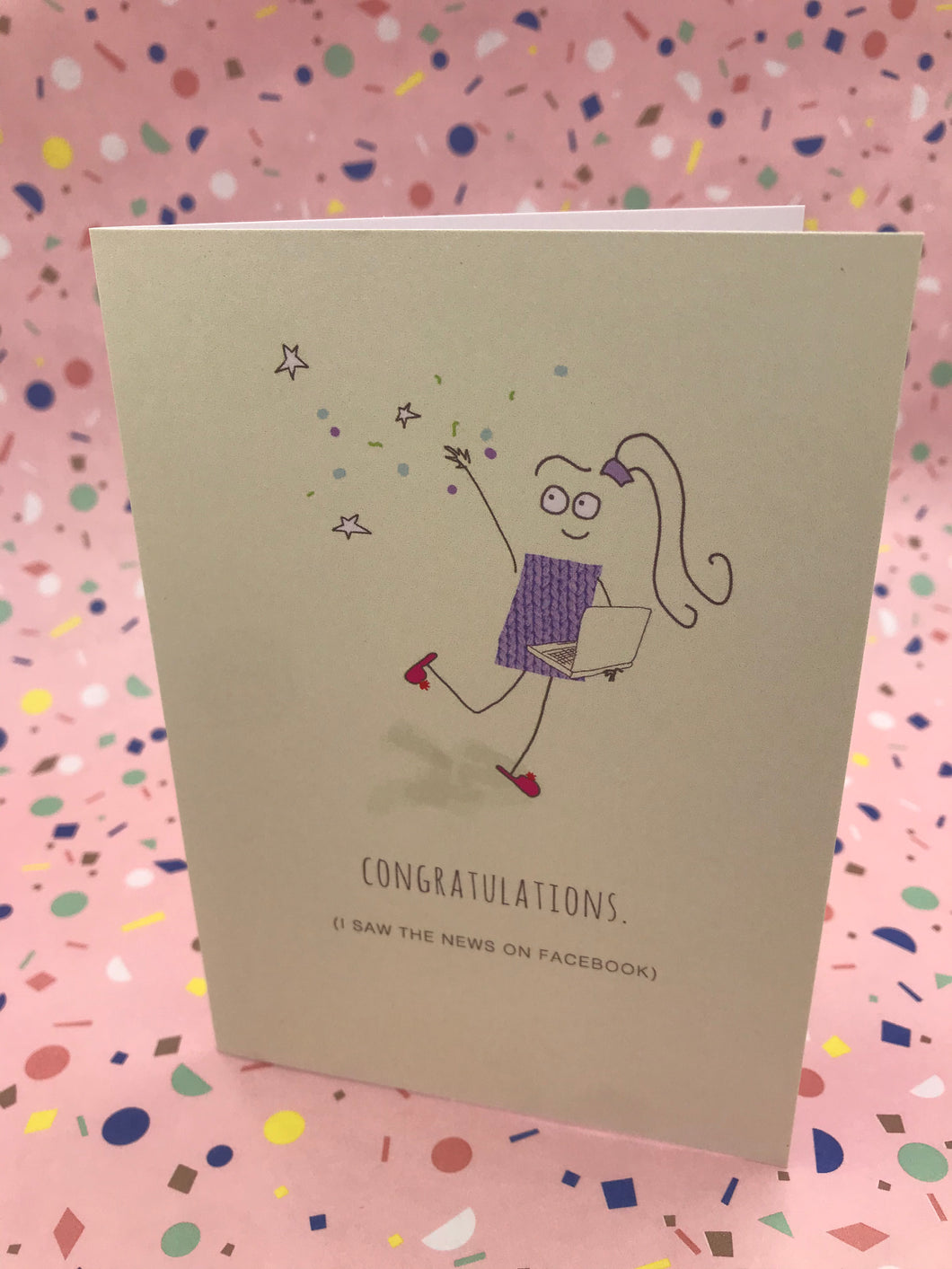An illustration of a girl wearing a knitted jumper saying congratulations