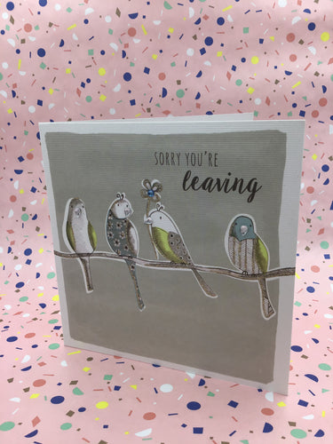 A grey card with four birds on a branch