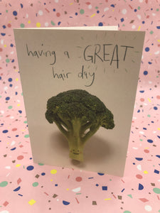 A photograph of a cute broccoli floret having a good hair day