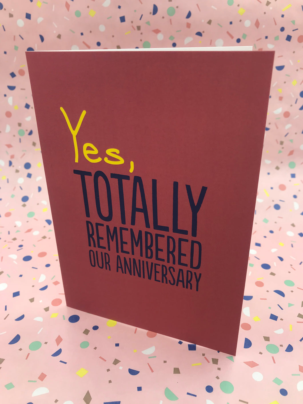 A red typography card with the words yes, totally remembered on the front