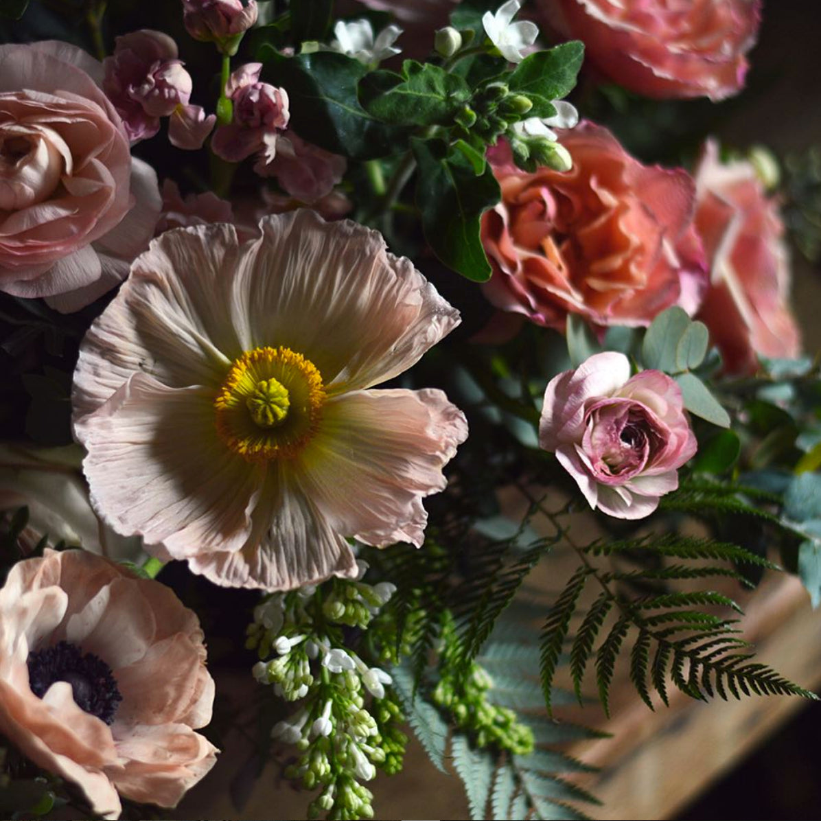 Picture of poppy and anemones in pale pinks