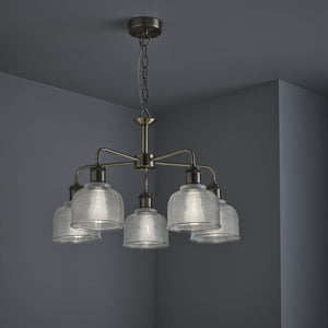 Industrial style 5 light ceiling light with holophane glass shades in antique brass finish