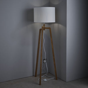 Wooden tripod floor lamp with rounded edge detail complete with white drum shade