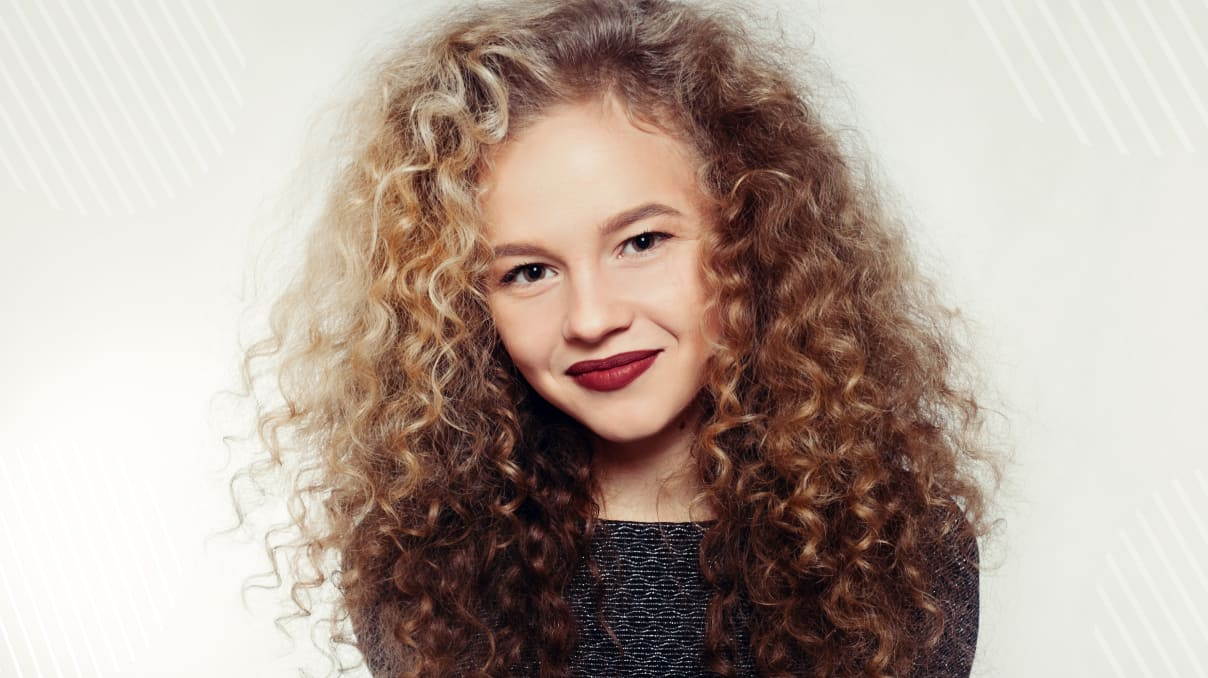 woman with perm hair smiling