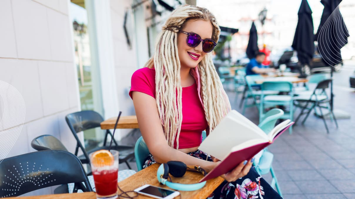 woman with beautiful braids reading a book