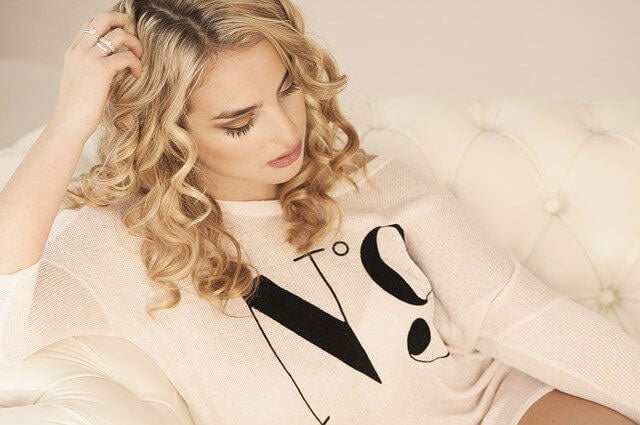girl with beautiful curly blond hair