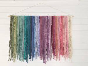 muted rainbow gradient fiber hanging made with chiffon, silk, cotton, and acrylic fibers