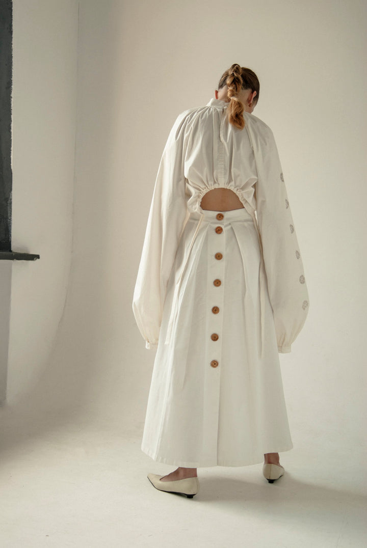 - WOODEN BUTTONS WHITE SKIRT