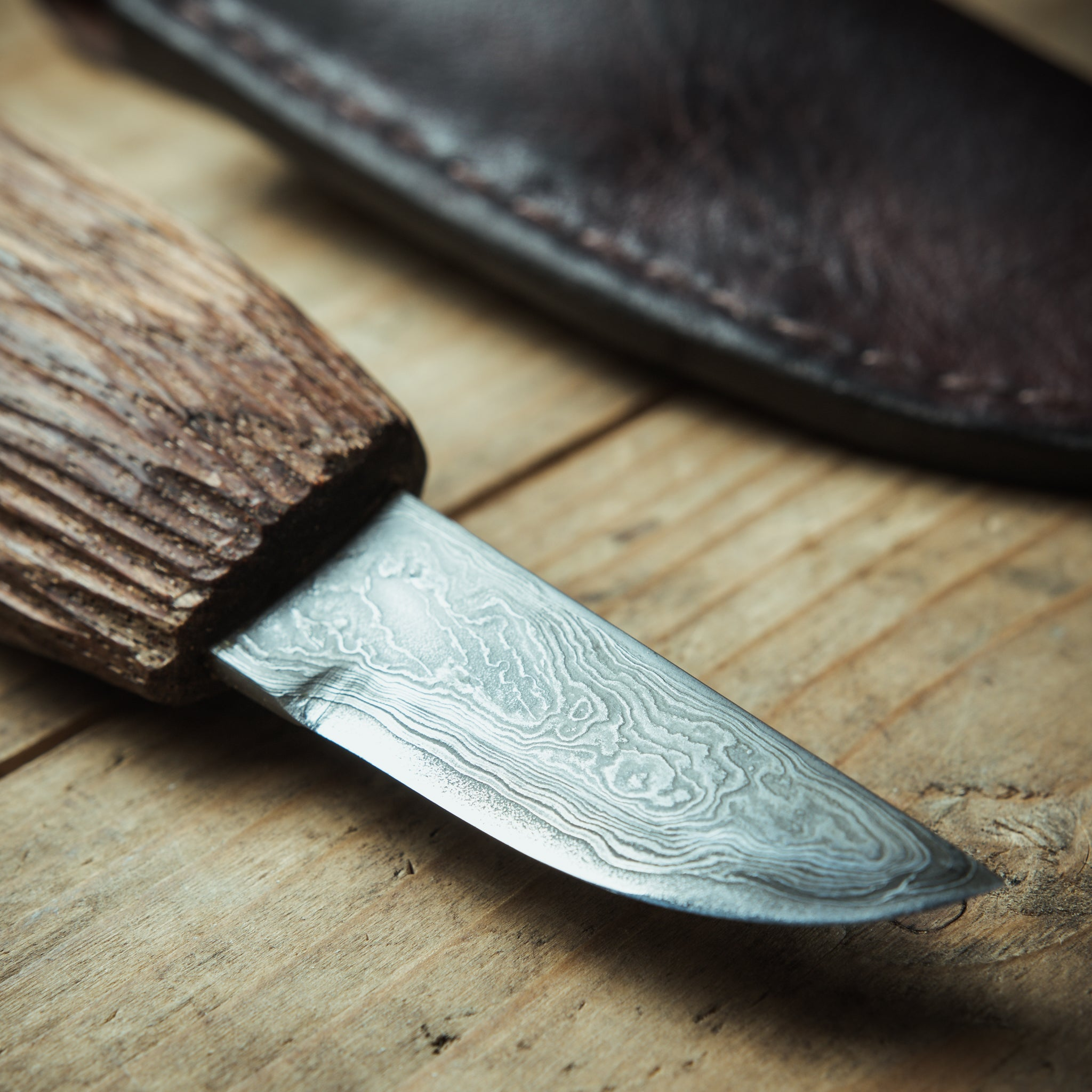"Handmade knife with pattern welded (""damascus"") blade"