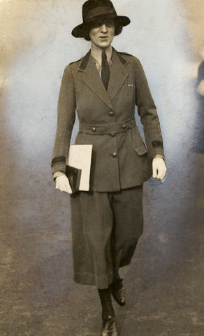 Old photos of woman wearing a suit, necktie and a hat