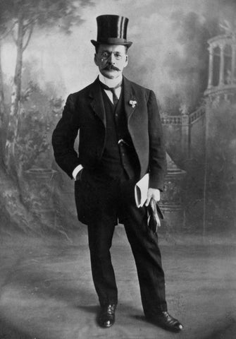 Old photo of Mr. E. G. Gilbert dressed in evening attire. Black and white, old style suit and top hat