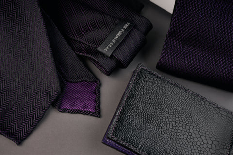 Formal classic accessories by The Purple seal: herringbone black tie, ostrich leather black and purple wallet, cotton and silk over the calf dress socks