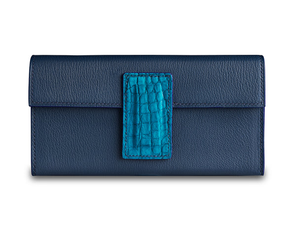 Handmade Aurora clutch bag in superb Navy Blue goat leather exterior and Cream goat leather interior, with real crocodile leather clasp. Made to order in the UK by The Purple Seal. Italian luxury clutch bag design
