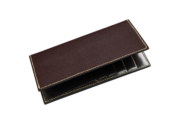 Burgundy coat wallet with black interior leather, black edges and yellow thread. 10 card slots and two long pockets along the height. Fully handmade to order in the UK by The purple Seal