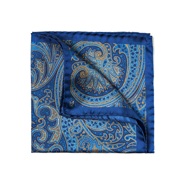 Blue and yellow 100% handmade and handrolled silk pocket square by The Purple Seal. Paisley pattern with blue borders.