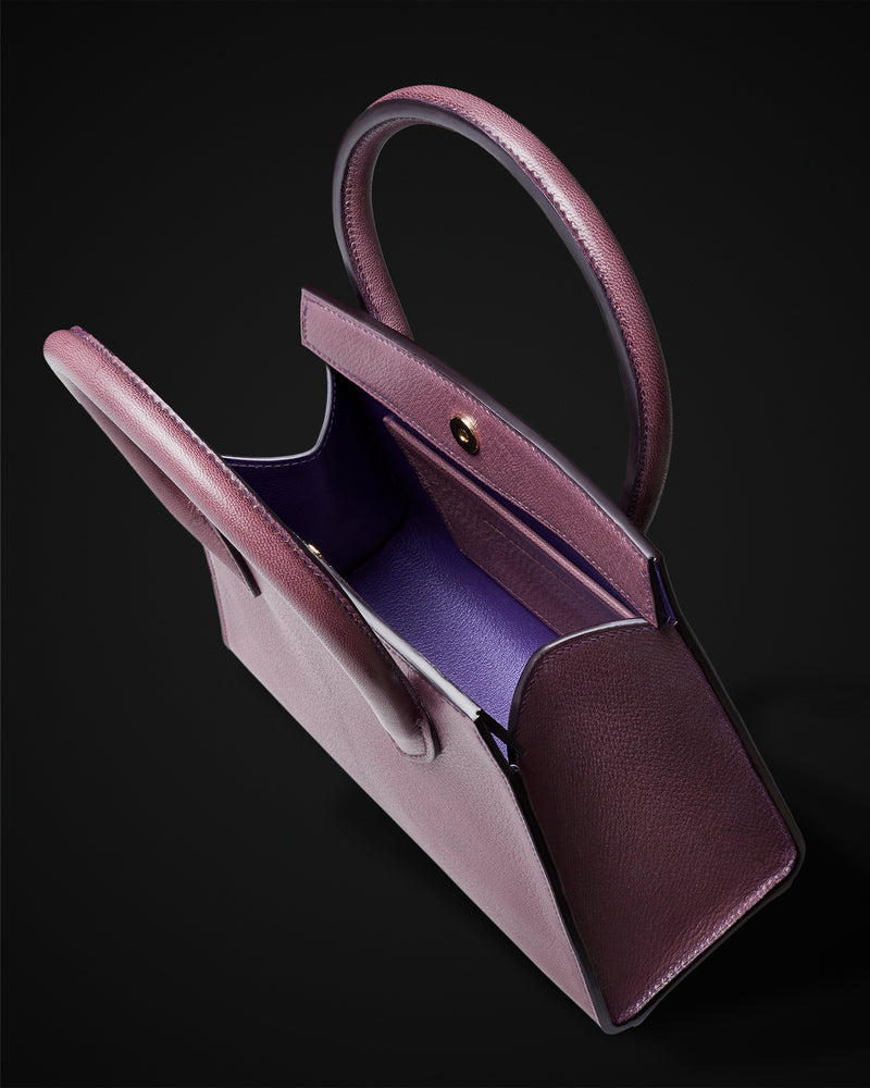 Plum goat leather handbag with purple interior and close-matching thread, handmade to order in the UK with top quality leather from France, solid brass feet, timeless classic design. The Purple Seal