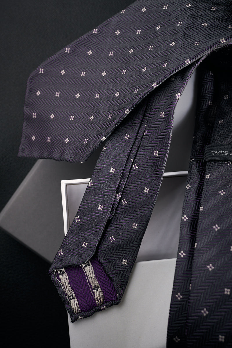 Grey seven fold silk tie - Jacquard herringbone pattern with flower/cross detail