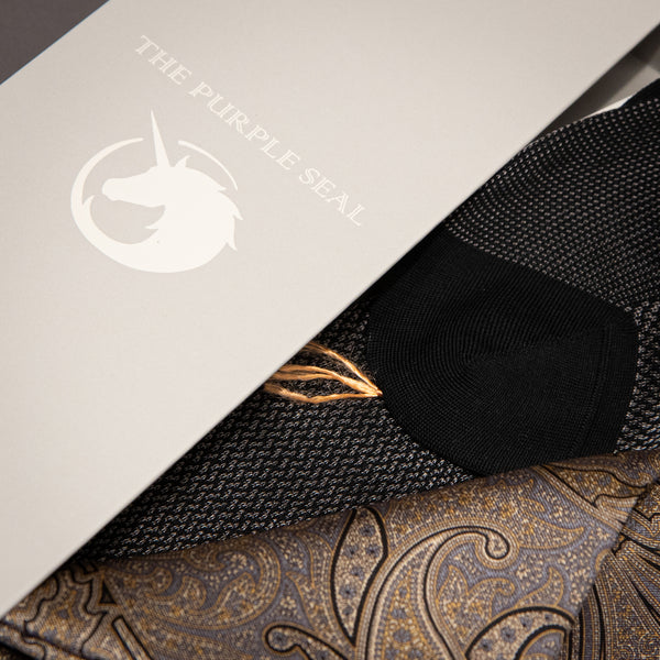 Image of The Purple Seal gold and silver silk pocket square and signature Charcoal grey cotton/silk dress socks in gift box with unicorn logo