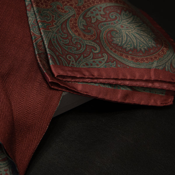 Pairing of burgundy and green silk handkerchief with wool and silk scarf.