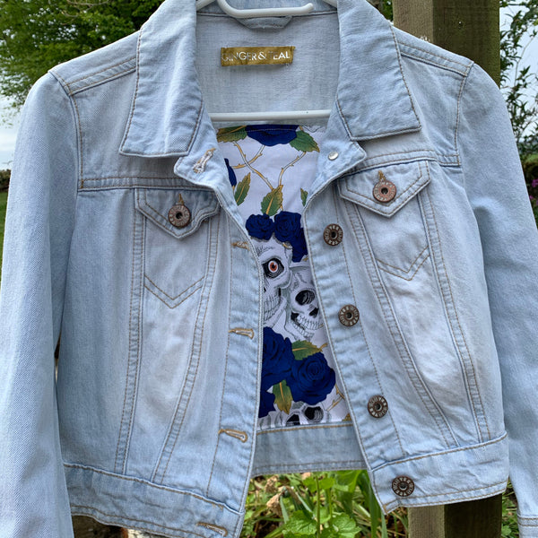 Denim jacket with drama mask embellishments