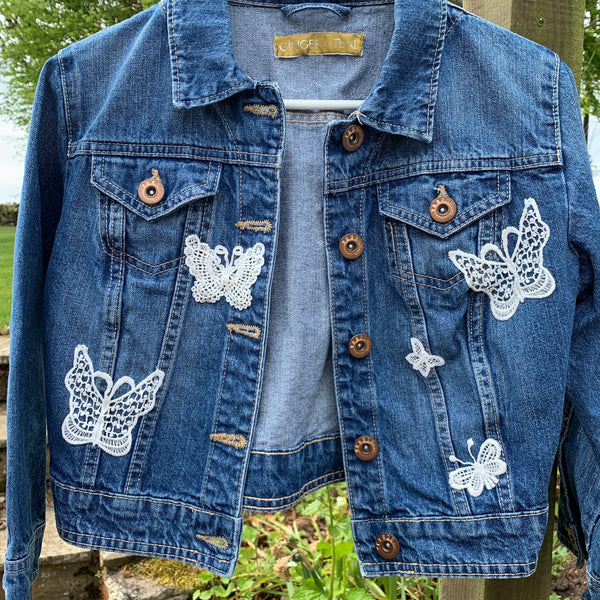 Denim jacket with butterfly embellishments
