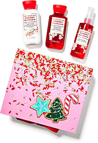Bath and Body Works JAPANESE CHERRY BLOSSOM Mini Gift Box Set 3 pc Travel Size arranged in an gift box with a ribbon.