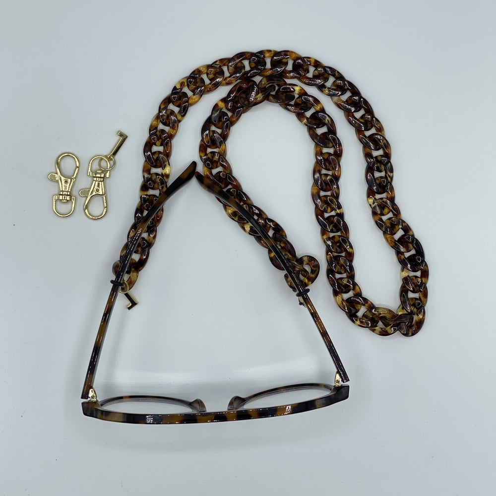 Michelle mouth cap & glasses chain in transparent brown leopard