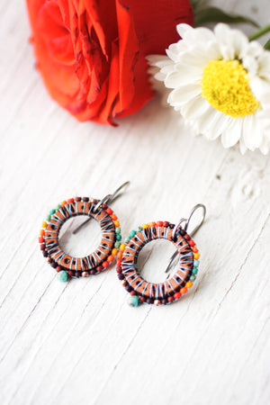 Reserved for Hillary - Southwestern Sun Dial beaded and leather earrings