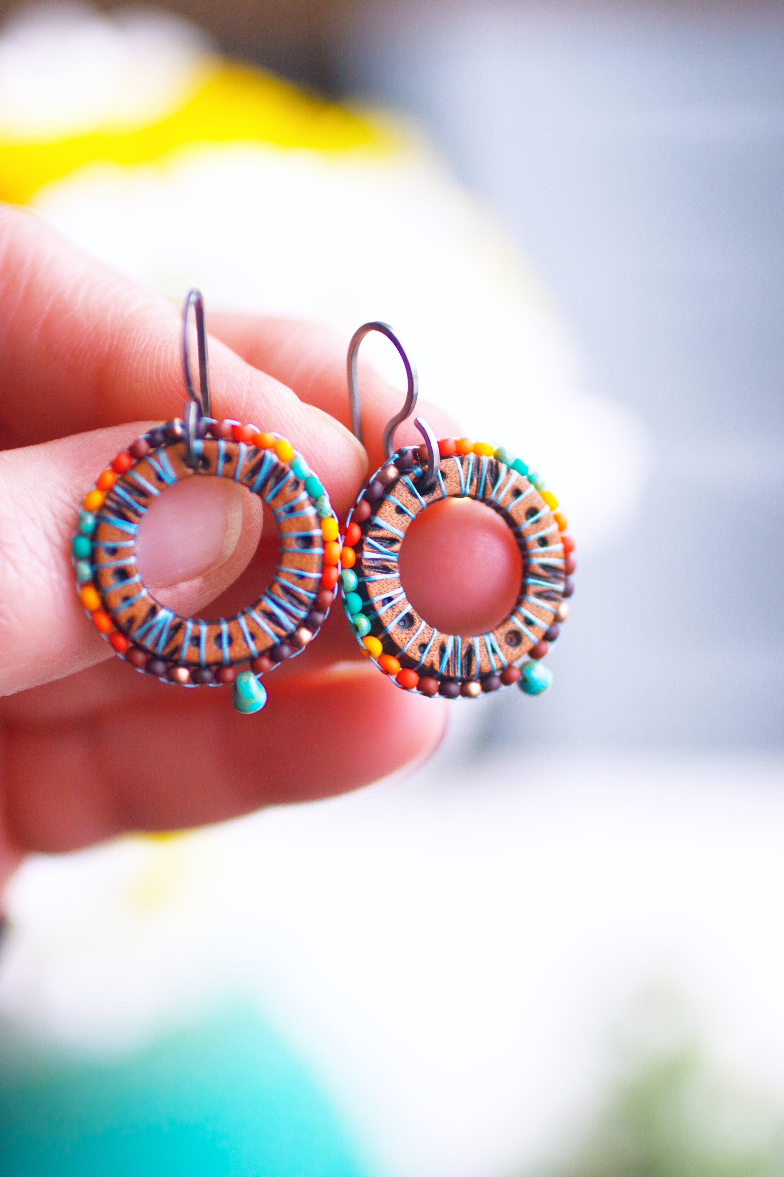 Southwestern Sun Dial beaded and leather earrings