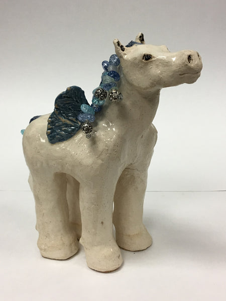 10 inches high by 7 inches long by 2 inches wide.  Clay with beaded mane and tail.