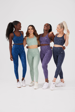 Group of girls posing wearing legacy scrunch bum leggings and sports bra in all colours