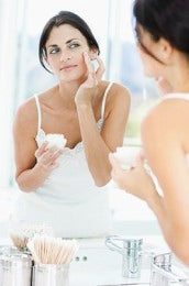misconceptions of skin care Woman applying beauty cream