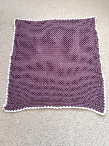 Knitted purple blanket