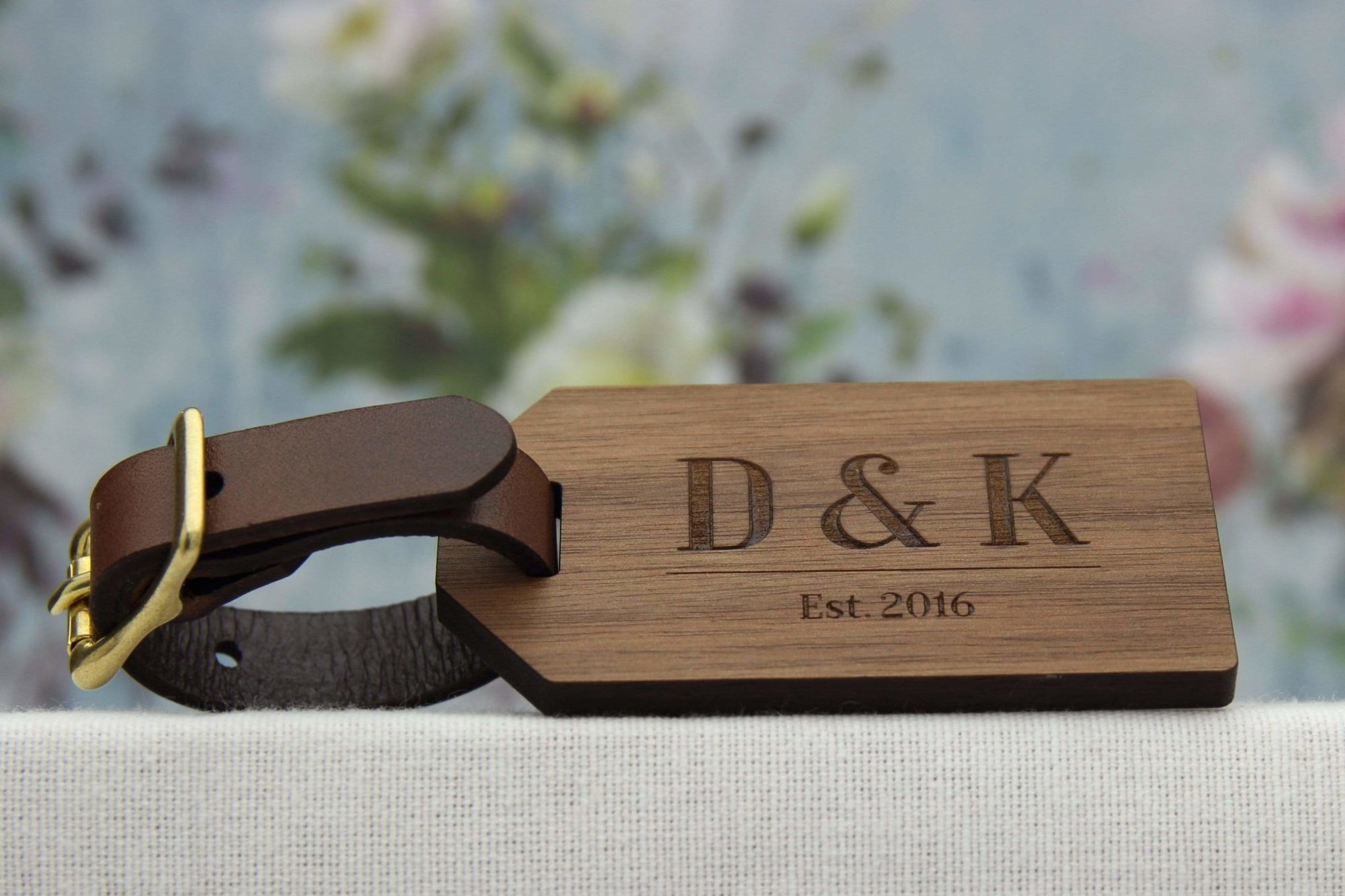 Wooden luggage tag personalised with initials and date