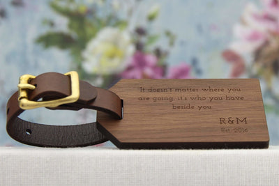 Luggage label with quote, initials and year engraved in wood