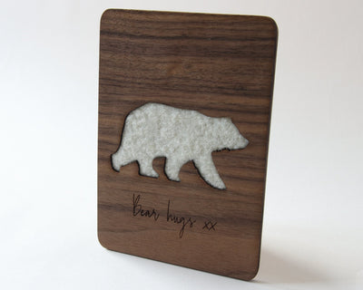 Bear hugs walnut wood card with wool bear