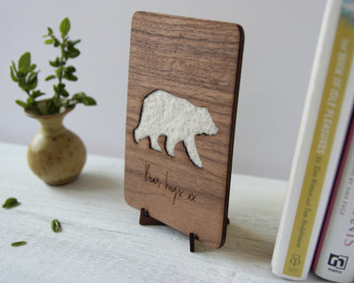 Bear hugs wood & wool card on bookshelf on wood stand