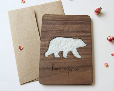Flat lay of wood card with bear for boyfriend or girlfriend