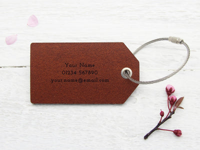 Personalised details on back of leather luggage label