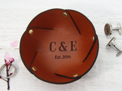 Personalised leather ring dish displayed with ring and cufflinks