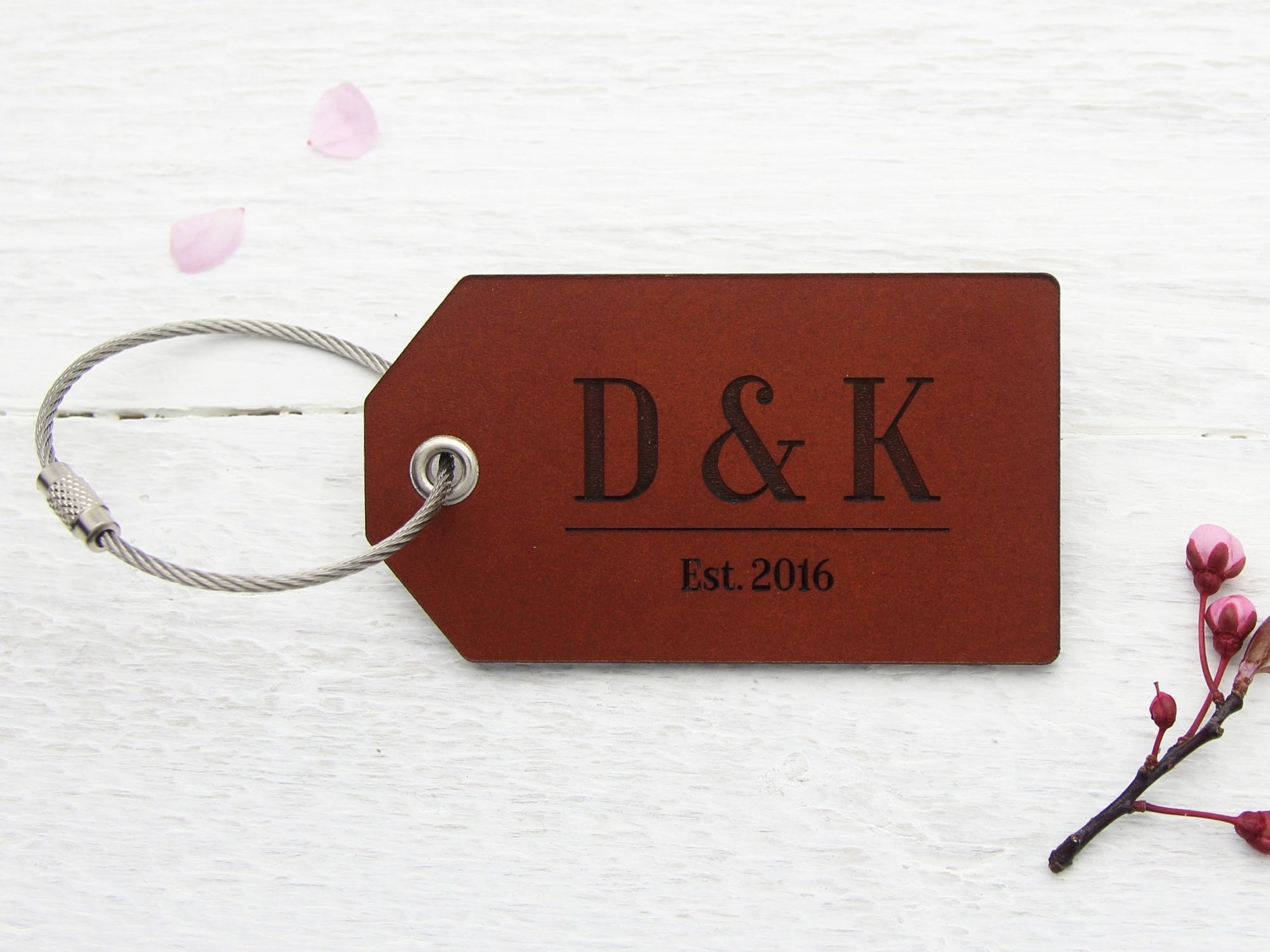 Luggage tag in leather personalised with initials and year