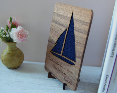 Blue sailing boat wood and wool card on stand