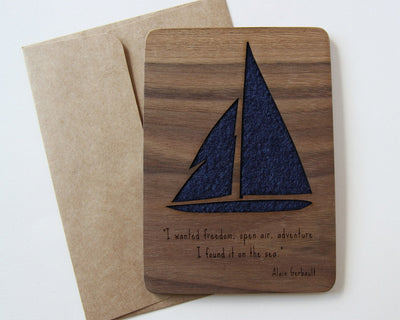 Sailboat wood card flat lay with envelope