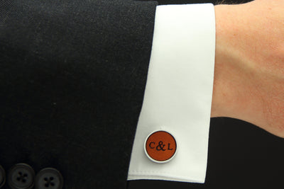 Model wearing leather cufflinks with initials and date
