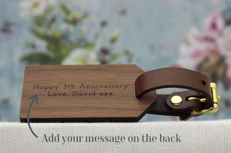 Luggage tag in wood personalised with lyrics, names and date